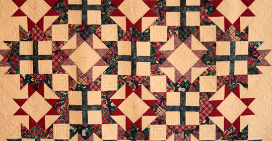 photo of green read and cream quilt