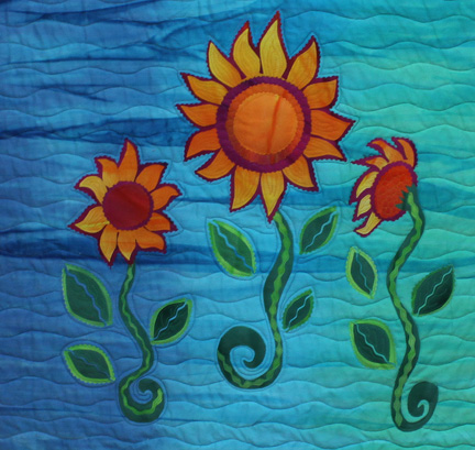 Quilt featuring colourful flowers on a blue background