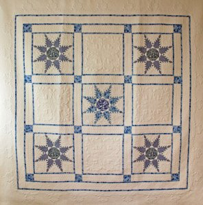blue and white machine quilt
