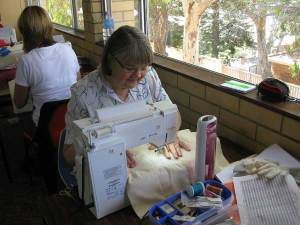 Jan busy at work quilting