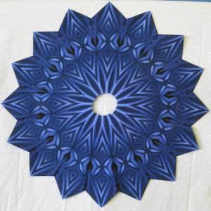Debs' Fancy Wheel using a Jinny Beyer Border Fabric
