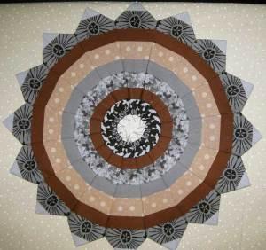 Margarets' fancy wheel using a stripe fabric